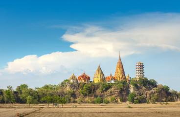big Buddha temple, Wat Tham Suea, on mountain Kanchanaburi Thailand