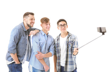 Handsome young men taking selfie on white background