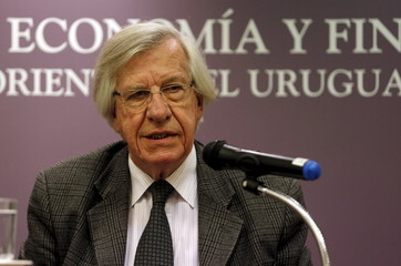 Uruguay's Economy Minister Danilo Astori speaks during a news conference to announce the emission of a new bond at the Economy Ministry building in Montevideo