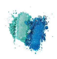Smears of crushed teal and blue shiny eyeshadow as sample of cosmetic product