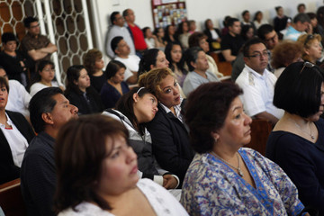 Pemex employees, friends and relatives of the Pemex employees, who died in an explosion at the company's headquarters, attend a mass in Mexico City