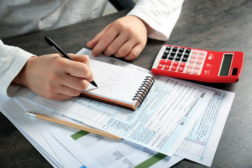 Man working with calculator and documents. Tax concept