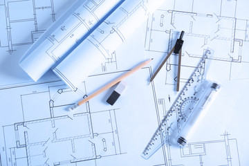 Office supplies on engineering drawings