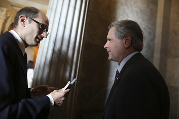 U.S. Senator John Hoeven talks to a reporter after a procedural vote to move forward on immigration reform legislation at the U.S. Capitol in Washington