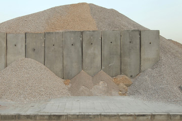 Sand piles over a concrete wall in a construction site near Beil in Beirut
