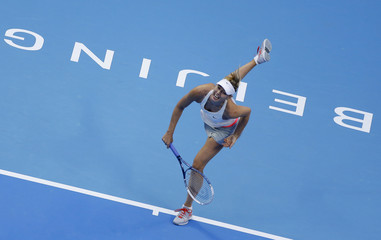 Sharapova of Russia returns a shot during her women's singles final match against Kvitova of the Czech Republic at the China Open tennis tournament in Beijing