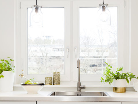 close up of a stylish kitchen sink by the window