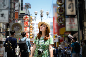 Woman tourist photographer is visiting at Shinsaibashi in Osaka, Japan