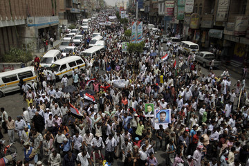 Anti-government protesters march to demand the ouster of Yemen's President Ali Abdullah Saleh in the southern city of Taiz
