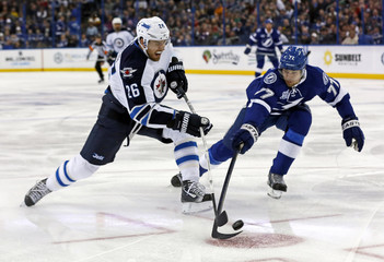 Winnipeg Jets' Wheeler has his shot deflected by Tampa Bay Lightning defenseman Hedman during the first period of their NHL hockey game in Tampa, Florida