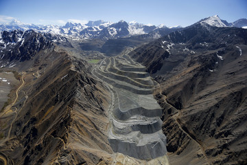 An aerial view of  Anglo American's Los Bronces copper mine with several  glaciers in the background at Los Andes Mountain range