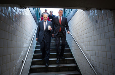 De Blasio and Schumer enter the New York City subway system to ride the R subway train during morning rush hour from Brooklyn to City Hall in Manhattan