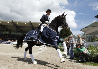 German rider Rath celebrates after winning the Freestyle competition at the World Equestrian Festival CHIO in Aachen