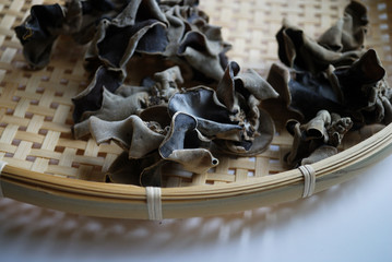 Dried wood ear mushrooms in a basket. Also known as ear wood or cat ear mushrooms. Popular ingredient in asian cuisine.