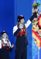 Gold medalist Justine Dufour-Lapointe of Canada and her compatriot, silver medalist Dufour-Lapointe, pose during the medal ceremony for the women's freestyle skiing moguls at the Sochi 2014 Sochi Winter Olympics