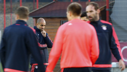 Coach Guardiola of Bayern Munich watches training session before Champions League soccer match against Arsenal in Munich