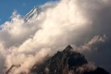 Fototapete - Clouds over the Langtang Lirung Peak