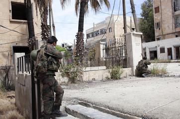 Forces loyal to Syria's President Bashar al-Assad take positions in al-Amriyeh neighbourhood