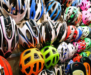 Stand with helmets on bicycle exhibition in showroom