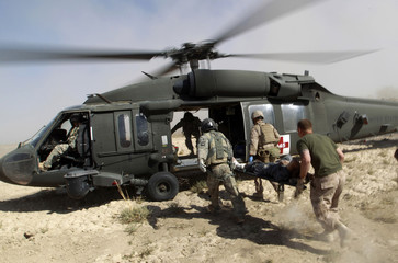 U.S. Marines carry an injured Afghan national to a helicopter during a Medevac mission in southern Afghanistan's Helmand province