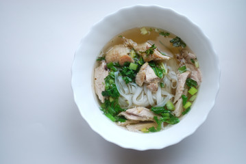 Bowl of chicken pho. Pho ga. Rice noodle soup.