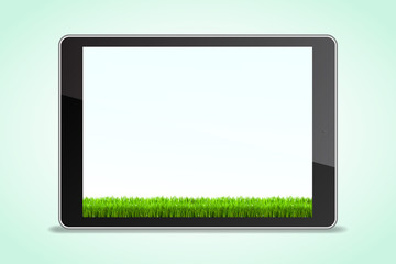 Tablet in realistic style with shadow with grass background