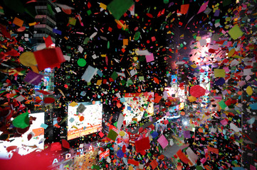 Confetti falls as the clock strikes midnight during New Year celebrations in Times Square in New York