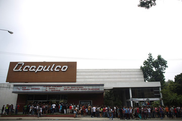 People line up at the entrance of a cinema where the Cuban Otaku festival is taking place in Havana, Cuba