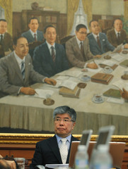 Kim, governor of the Bank of Korea, waits to start the Monetary Policy Committee meeting at the bank's headquarters in Seoul