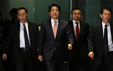 Japan's PM Abe arrives at his official residence as he returns from his Middle East trip, in Tokyo