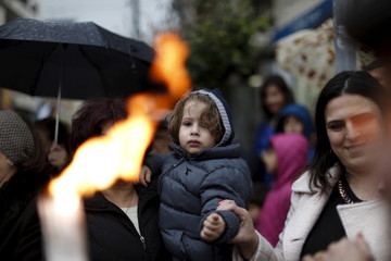 Palestinian Orthodox Christians celebrate the arrival of the 'Holy Fire' from Jerusalem's Holy Sepulchre in the occupied West Bank city of Ramallah