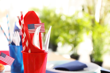 Plastic ware for picnic on blurred background