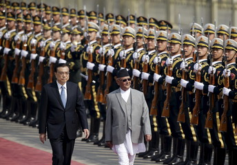 Nepal's Prime Minister Khadga Prasad Sharma Oli and China's Premier Li Keqiang review honour guards during a welcoming ceremony at the Great Hall of the People in Beijing
