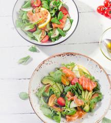 Fresh Salmon salad with cherry tomatoes,  arugula, and avocado