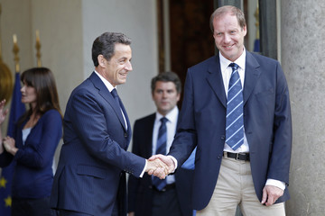 France's President Sarkozy shakes hands with Tour de France Director Prudhomme at the Elysee Palace in Paris