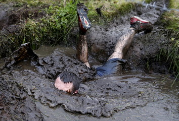 Man takes part in an extreme run competition in Zhodino