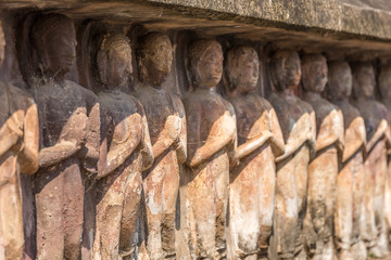 Stone buddha statues with salute hands. Buddha statues with respect hand