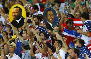 Fans of the U.S. hold up pictures of Martin Luther King Jr and U.S. President Barack Obama before the 2014 World Cup Group G soccer match between Ghana and the U.S. at the Dunas arena