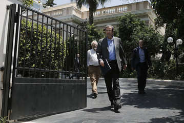 Greece's Prime Minister's Samaras leaves his office in Athens