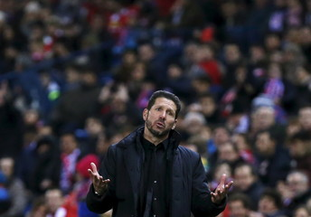 Atletico Madrid's coach Diego Simeone reacts during the match.