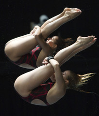 Carol-Ann Ware and Pamela Ware of Canada compete during the women's synchronized 10m platform final at the Canada Cup 2012 diving competition in Montreal