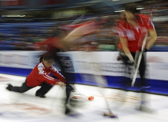 U.S. skip Pottinger delivers a stone during her draw against Canada at the World Women's Curling Championships in St. John
