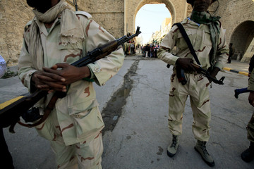 Libyan army soldiers patrol the old city of Tripoli
