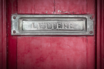 Letter box in a red door