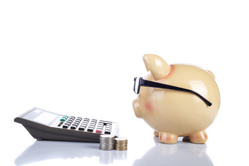 Piggybank with glasses and a calculator