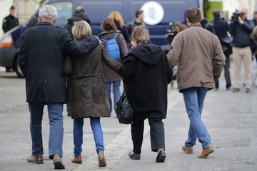 People comfort each other as they walk in the street in Puisseguin the day after 41 elderly-day trippers perished in a bus accident