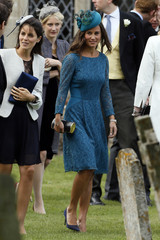 Pippa Middleton the sister of Catherine Duchess of Cambridge leaves after the wedding of James Meade and Laura Marsham at St Nicholas Church in Gayton, eastern England