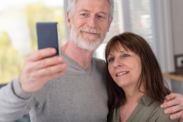 Mature couple taking a selfie