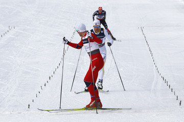 Northug of Norway crosses finish line ahead of Hellner of Sweden and Angerer of Germany during men's cross-country 4 x 10 km relay race at Nordic Ski World Championships in Oslo