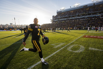 Tiger-Cats Medlock celebrates after kicking the game winning field goal to defeat the Argonauts at the end of their their CFL football game in Hamilton